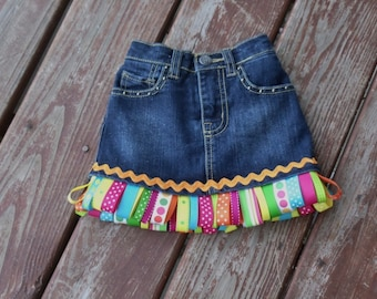 ASSORTED colors  RIBbON FRINGE denim skirt or jeans sizes 0 - 3 - 6 - 9 - 12 -18 -24 mth -2 -3 -4 -5- 6- 7- 8   several color options