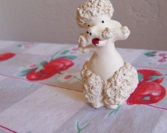 little plaster poodle figurine