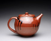 handmade ceramic teapot, tea kettle with iron red and green celadon glazes