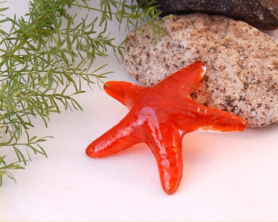 Fused glass transparent orange sea star paperweight