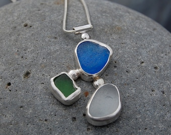 """Handmade, ocean tumbled blue, green and white seaglass bezel set in sterling silver """"LOW TIDE"""" necklace"""