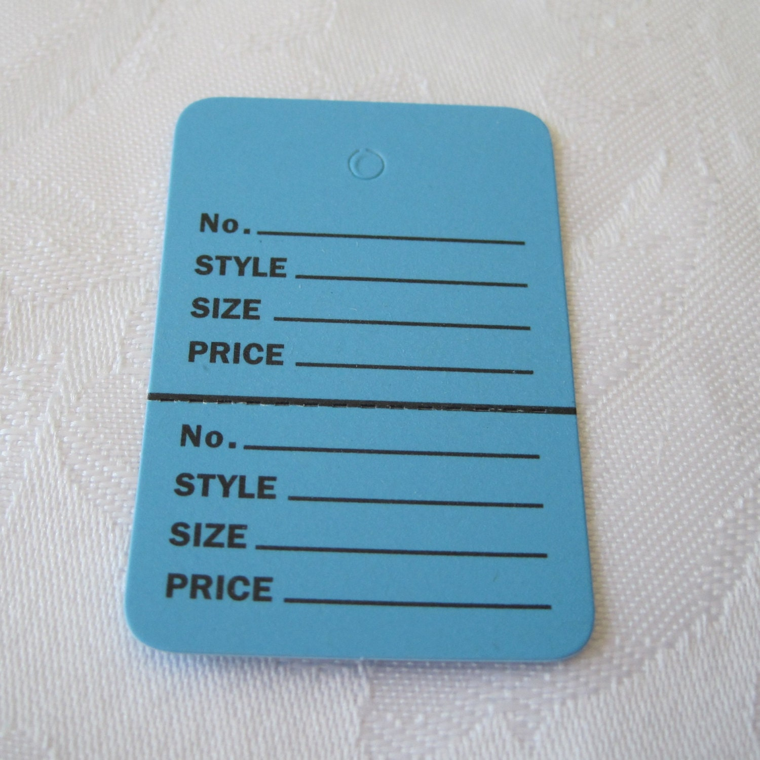 How to Attach Price Tags to Clothes | Bizfluent |Price Tags For Clothing