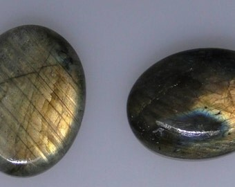 2 Labradorite oval cabs, 46.14 carats total weight, nice color flashes                   043-10-160
