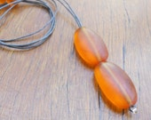 Resin bead necklace juicy orange double drop ovals on cotton cord