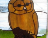 Stained Glass Owl on a tree trunk