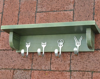 Fun Green shelf for Pet Lovers made with antique silver forks