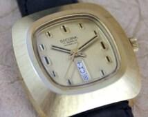 Sicura Watch - 17 Jewel Wind Up Mechanical Movement - Gold Tone - Swiss Made - Retro Watch - Circa 1970's - Incabloc - Day Date