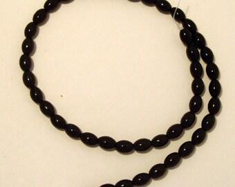 Full Strand of Black Onyx 7mm wide  by 9 mm long Barrel  Gemstones  (111)