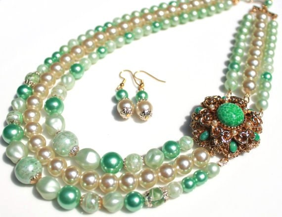 Seafoam green cream vintage beads necklace adorned with a Sphinx vintage jade glass brooch