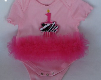 Onesies with tu tu around middle with your choice of cupcake