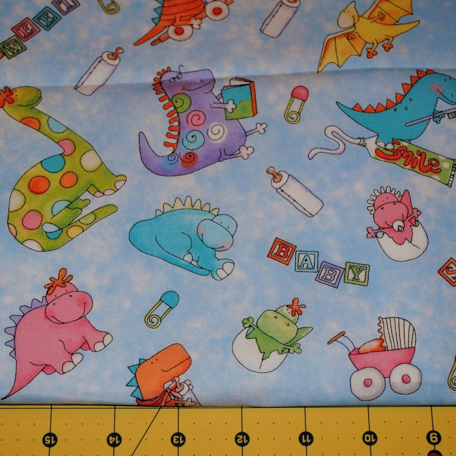 Fat quarter adorable baby dinosaur fabric for Dinosaur fabric