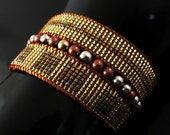 Golden bead loomed woven bracelet cuff with metal beads