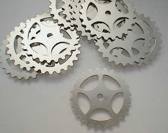 12 large nickel silver gear-sprocket charms/stampings, 1""