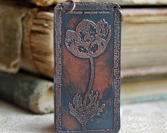 FLOWERS...  beautiful etched pendant...   T 16