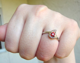 Simple silver tear drop ring with red crystal- size 7