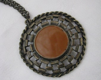 Round antiqued gold tone pendant necklace with cocoa brown enamel inset