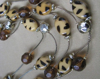 Multi strand vintage bead necklace with tortoise, gold, & multi color beads