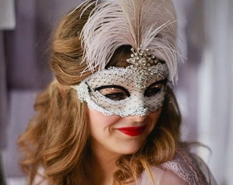 Luxe Peacock feather jeweled mask in blush black ivory and white with veil