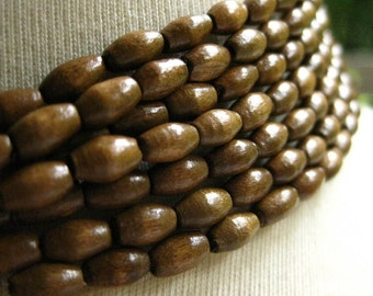 Wooden Chocolate Brown Finish Oval Rice Beads 7mm by 4mm 8 inches (20cm)