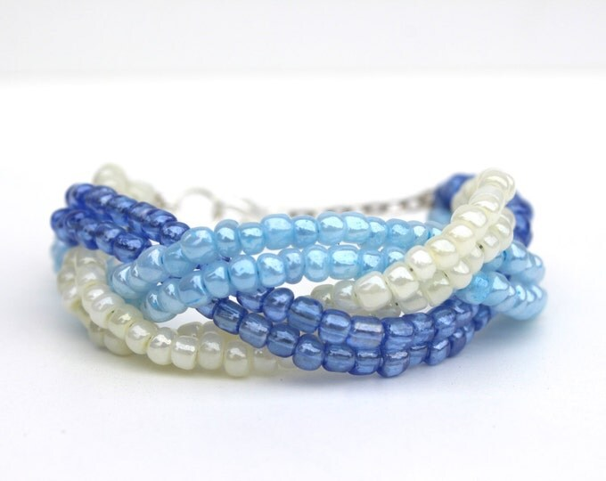 Cream light blue and ocean blue beaded bracelet.