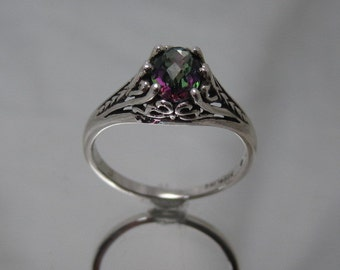 Sterling silver filigree ring with mystic topaz.