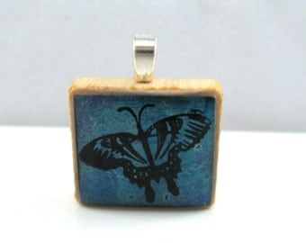 Blue butterfly - Glowing metallic Scrabble tile pendant