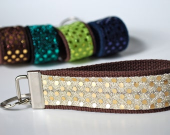 Key fob sparkle sequin fabric wristlet in creamy off-white and matte gold color