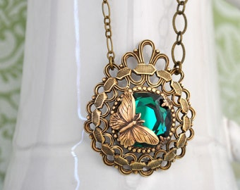 BUTTERFLY IN MOTION Neo Victorian style necklace with butterfly and Swarovski Emerald green glass cab