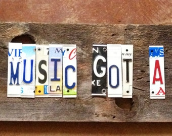Sold VOODOO Music got a hold of me OOAK upcycled recycled license plate art sign tomboyART tomboy J B Lenoir