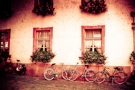 Bicycle Photography germany bikes street cobble flowers window boxes geraniums pink green - Radstander, the bike stand - fine art photograph