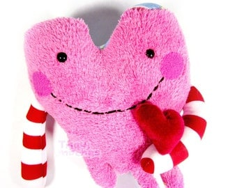 Fidoo.  a cute pink and red  dripping heart character, 'corazon chorreante'. special St Valentine's Day