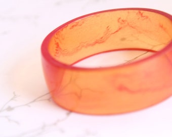 Orange swirl wide resin bangle bracelet jewelry for petite hands , tangerine resin jewelry ,  broad small kids bracelet , children jewelry