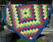 Handmade trip around the world quilt in vivid colors.