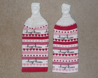 Crocheted Topped Hanging Kitchen Towels:  Hugs and Kisses towels with white yarn toppers