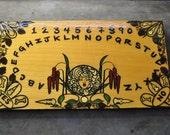 Lady of white Ouija Board