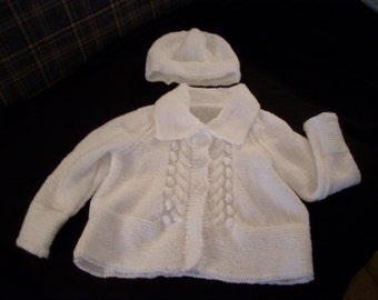Hand knit baby girl's white cardigan and hat