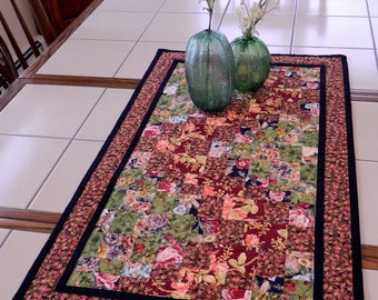 Handcrafted Quilted Floral Table Runner with reds and greens