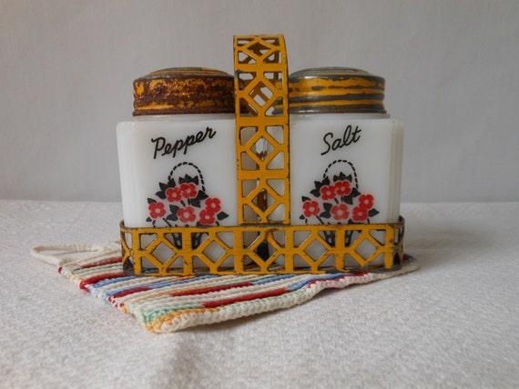 Vintage Salt and Pepper With Yellow Metal Carrier - Red, White, Yellow