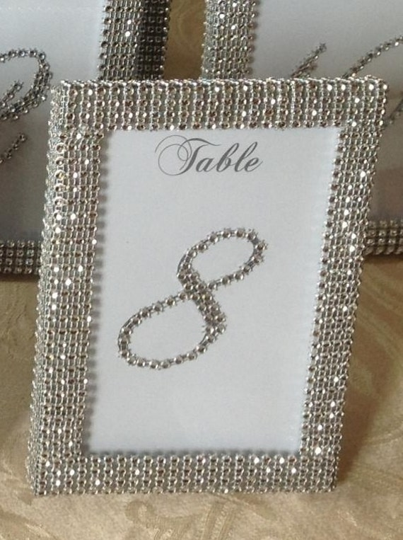 frames in silver rhinestone ribbon and 10
