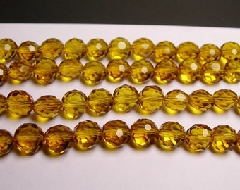 Crystal faceted oval round - 50pcs -  9 mm - AA quality - light amber -18 inch strand