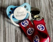 Blue anchors on red pacifier clip