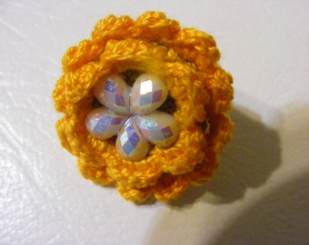 Crocheted 100%  Egyptian cotton yarn flower ring in golden yellow, red and green with plastic stones