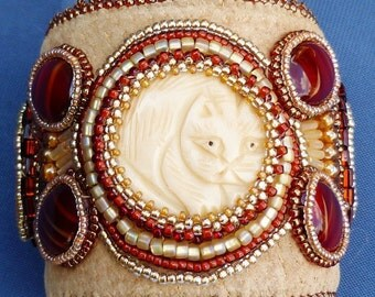 bone cat bead embroidered suede leather cuff