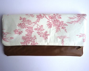 Limited edition clutch bag with vintage style print and tan leather
