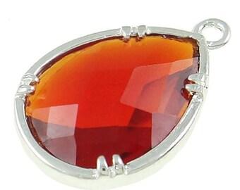 2 framed glass pendants burnt orange color matte silver with faceted cut gp03