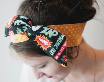 Large Dolly Bow Superhero Comic Words with Orange Polka Dots, Pin Up Wire Headband Rockabilly Teen Woman
