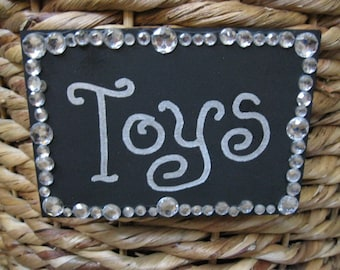 TOYS sign with bling Velcro attached to back and ready to peel and stick on any surface