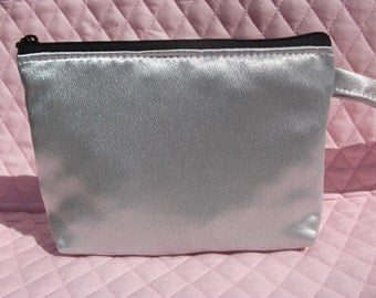 Silver/Grey Makeup bag. We have other colors