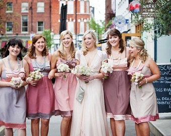 Contrast pastel colours silk bridesmaid summer dress. Cute bow detail and spaghetti straps. Different colours/lengths/fabrics available.
