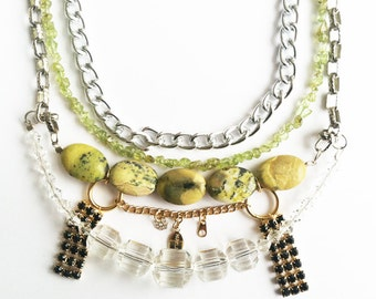 Multilayered necklace with yellow turquoise, peridot, and chains